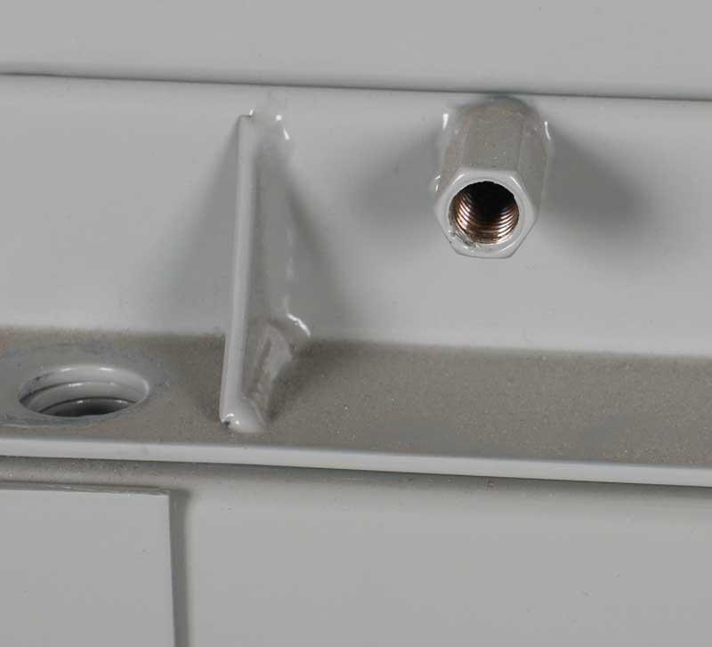 dual external, diagonally opposite side, grounding bosses are welded to the base